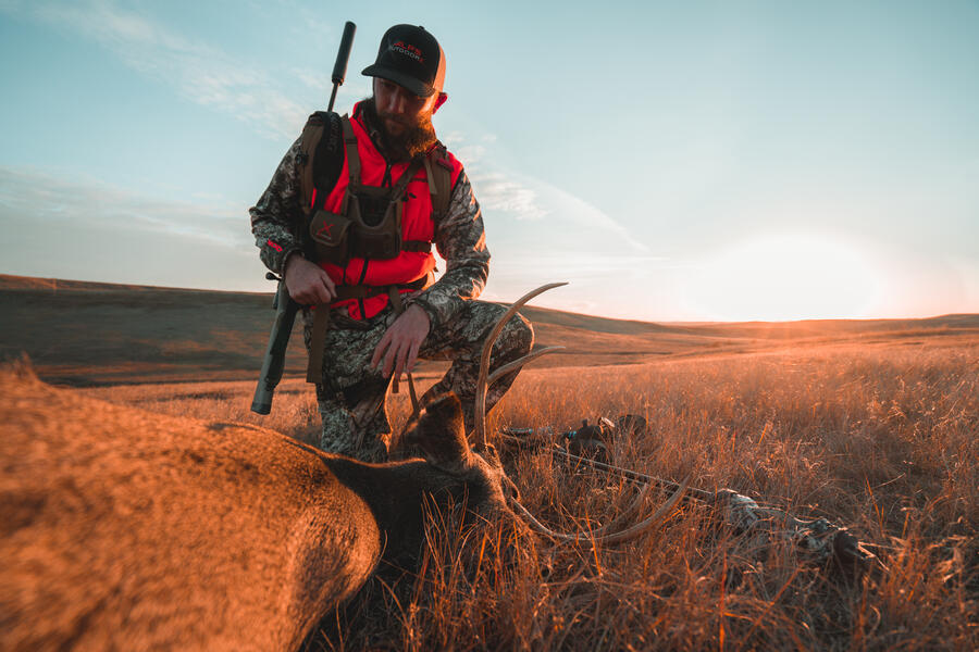 Josh Dahlke with a mule deer kill on a hunt in Wyoming